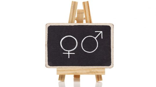 Male and female sex drawn on a blackboard